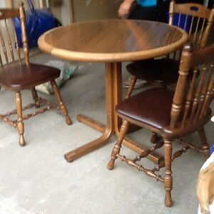 Solid oak kitchen table and 4 chairs