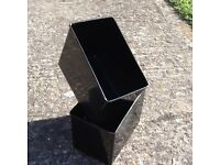 black plastic garage parts containers