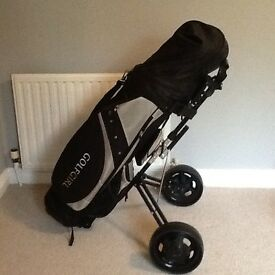 Ladies unused golf clubs and trolley