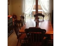 Good condition extending table and 6 chairs.