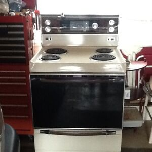 Almond Kenmore electric stove