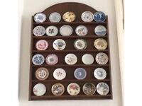 26 Franklin Mint miniature porcelain plates with display shelf
