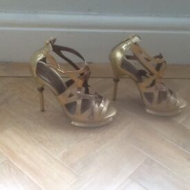 Gold Carvella high womens shoes ,size 7