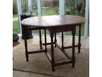 Dining table, drop leaf, excellent condition. Solid mahogany, circa 1900's