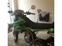 Kawasaki Klx 250s 2009 less than 3k very good cond
