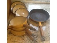 3 piece Le Creuset Saucepan set and frying pan in yellow.
