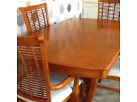 Beautiful dining table with 6 chairs (2carvers)