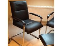 Chrome and faux leather chairs