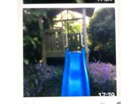 Lovely childrens playhouse with slide
