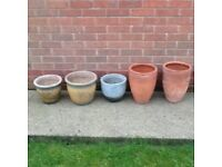 Selection of terracotta, composite and glazed plant pots.