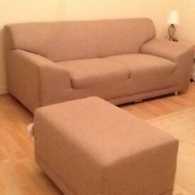 2-seater fabric neutral sofa plus footstool. Used but in very good condition.