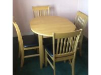 Oval extending kitchen table with four chairs