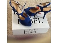 Blue never worn high heel shoes size 6 (39) heel height is approx 4.5 inches