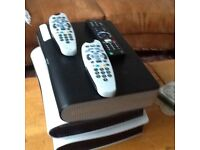 3 sky boxes with remote controls, two of them with sky cards