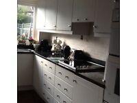 Black granite worktop,breakfast bar windowsill and upstands