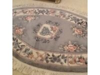 Pale green oval rug with fringing