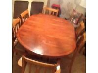Dining table and 6 chairs (2 carvers) 64 inches extends to 85 inches in yew wood