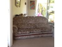 2 matching three seater sofas. Fawn velour with flowers