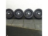Dynamic sport wheels and Firestone tyres,245x40x18, between 2 and 4 mm, came off jag, also fit ford