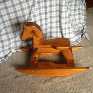Child's hand carved rocking horse.