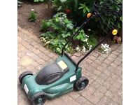 Small electric lawn mower with grass collector. Hardly used.