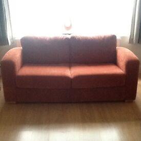 Rustic red 2 seater sofa.