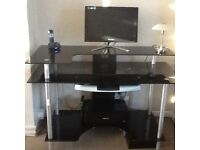 Black glass computer desk with brushed silver effect and chair