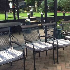 Garden table with 6 chairs good quality armed chairs with cushions