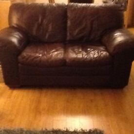 Brown leather two seater settee for sale