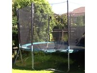 TRAMPOLINE, 12FT ROUND, COMPLETE WITH PERIMETER PAD AND SAFETY NET CAGE.
