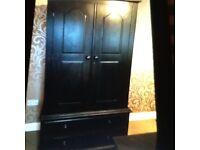 Solid pine wardrobe painted black.