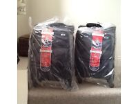 Brand new carry on suitcases, unused, still in wrapping and box