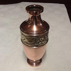 Brass over copper vase