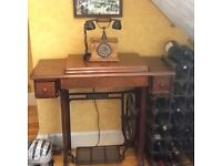 Old Singer treadle sewing machine table. No actual sewing machine in it.