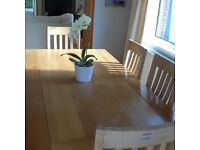 Light oak solid table chairs and cabinet from Creations