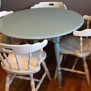 Dining table w/4 cream chairs