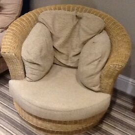Swivel armchair, wicker base with removable beige cushions