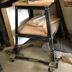 Tool stand with movable base