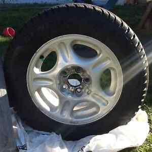Like new 15 inch Studded Winter 205/65 Tire