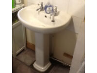 Bathroom pedestal basin with sink and bathroom taps