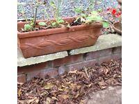 8 X trough terracotta planters measuring 48x 20cm