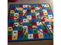 Snakes and ladders kids floor rug.