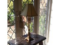 Gold ornate lamp with shade