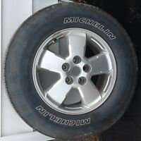 Four michelin latitude tire with rim and sensor for sale.