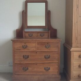 Dressing table with drawers and attached mirror.