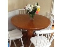 Pine dining table and four white chairs