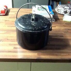 Old black enamel pot