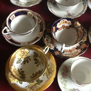 China, cups and saucers, fine bone numbered footed china
