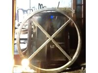 Circular large wooden frame, possible window