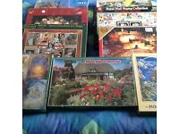 9 unopened jigsaw puzzles Will sell separately